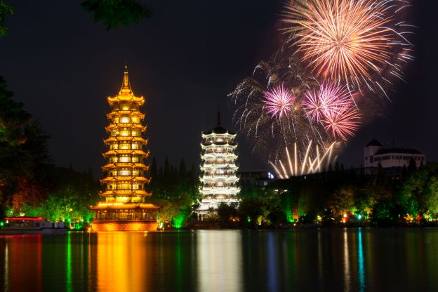 fireworks over two towers of guilin in china