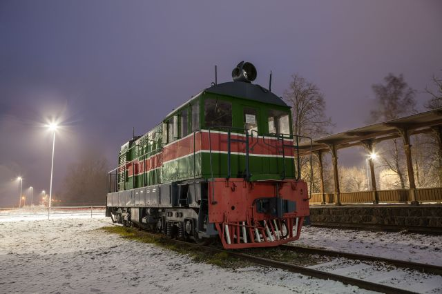 old train at vintage station in winter time